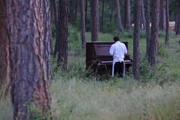Chef plays an abandoned piano in the Okanagan
