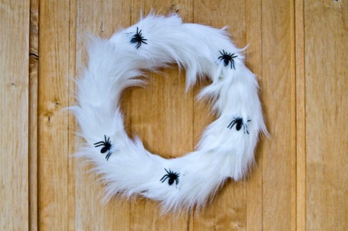 white fur halloween wreath with spiders