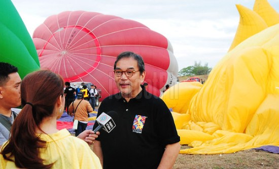 Department of Tourism (DOT) Secretary Mon Jimenez while being interviewed for a news channel.