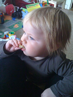 baby eating with fingers
