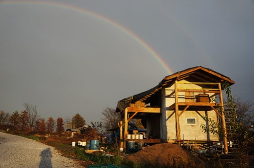 Rainbow over straw bale house