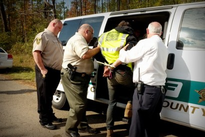 Blockader being arrested at lock down site
