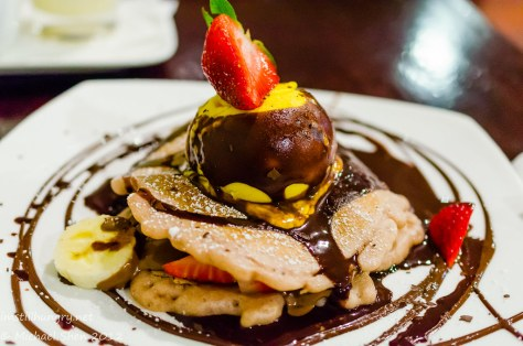 The Chocolate Room Vanilla crepes (pancakes?) w/mango ice cream, bananas & strawberries topped with chocolate sauce