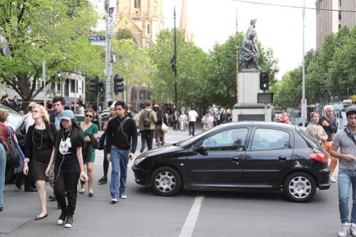 Dimwit blocks the pedestrian crossing at Swanston and Collins Streets