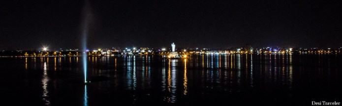 buddha statue in Hussain Sagar tank bund lights in evening