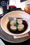 Duck and Pistachio Cabbage Rolls with Mushroom Consomme and Baby Herbs