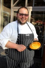 Chef Artie McGee holding fresh cornbread