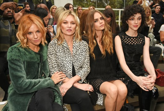 LONDON, ENGLAND - SEPTEMBER 21: (L to R) Sienna Miller, Kate Moss, Cara Delevingne and St Vincent attend the Burberry Womenswear Spring/Summer 2016 show during London Fashion Week at Kensington Gardens on September 21, 2015 in London, England. (Photo by David M. Benett/Dave Benett/Getty Images for Burberry) *** Local Caption *** Sienna Miller;Kate Moss;Cara Delevingne;St Vincent