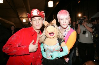 NEW YORK - FEBRUARY 04: Heatherette designers Traver Rains and Richie Rich poses with Miss Piggy backstage at the Heatherette Fall 2005 show during the Olympus Fashion Week at Bryant Park February 4, 2005 in New York City. (Photo by Carlo Allegri/Getty Images)
