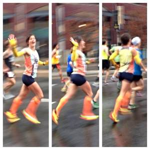 Looking fast and fab at mile 1. These are the only pics you'll see of me waving at this race, I swear.