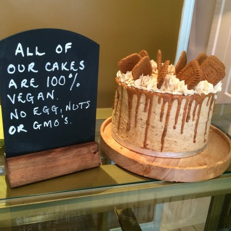 vegan cake and sign