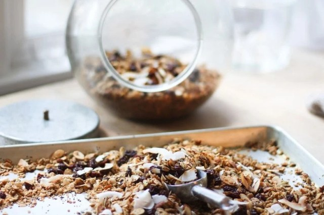 Easy Overnight Granola packed with clusters of nuts & seeds, coconut flakes, sweetened w/ maple. 5 minutes of prep, bakes overnight. Vegan and Gluten free! | www.feastingathome.com