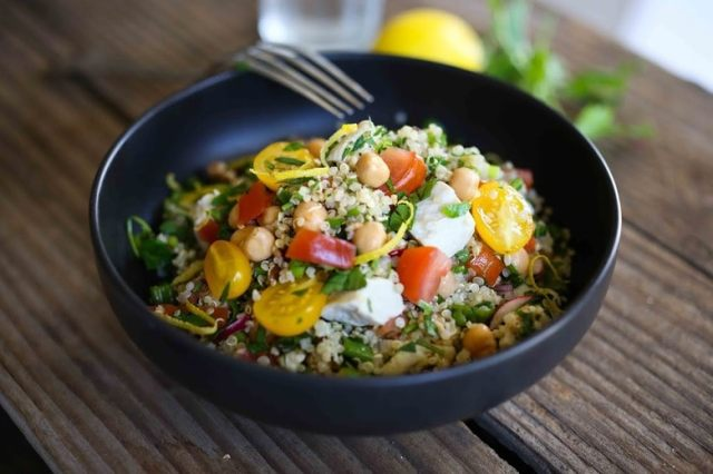 A delicious recipe for Quinoa Salad with summer tomatoes, Chicken (or Chickpea), mint parsley and a zesty lemony dressing. | www.feastingathome.com