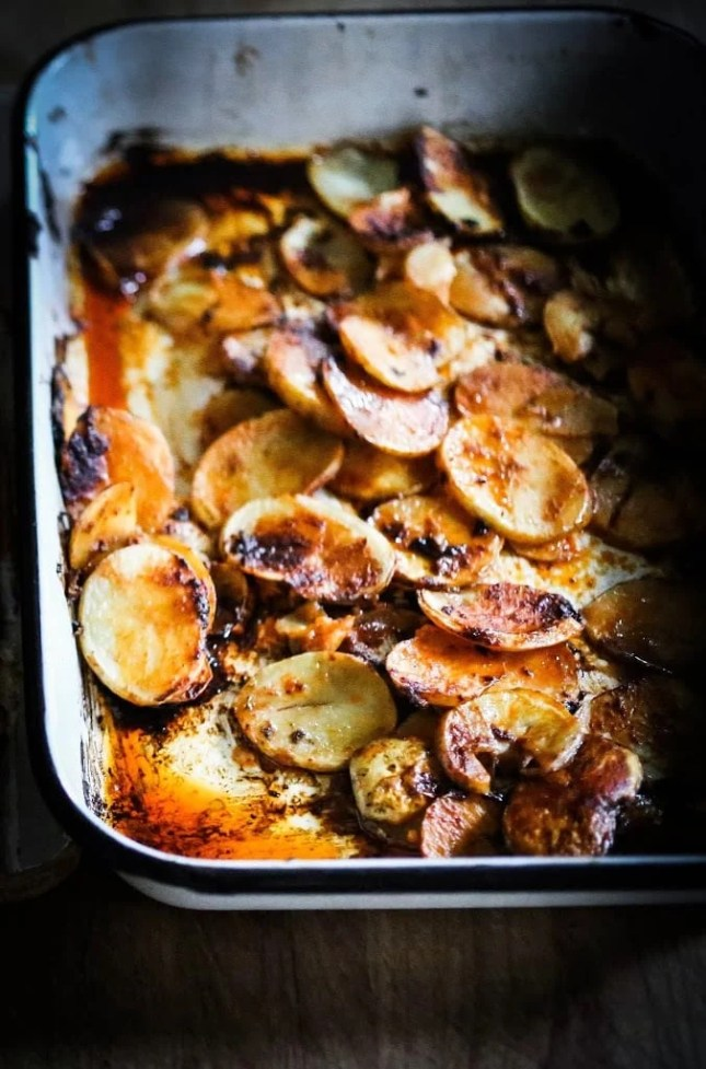 Portuguese Chicken with Crispy Potatoes...smokey spicy, crispy skinned tender chicken baked over sliced potatoes...my favorite chicken recipe!   www.feastingathome.com