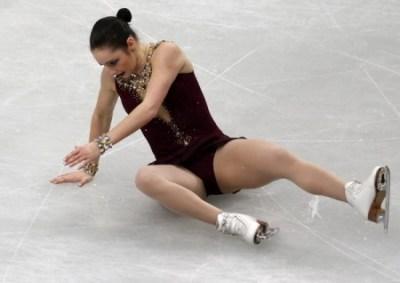 Canada's Osmond falls during the women's free program at the ISU World Figure Skating Championships in Saitama
