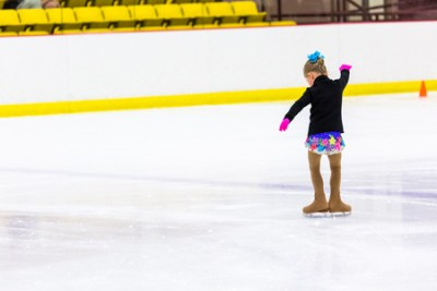38767166 - young figure skater practicing at indoor skating rink.