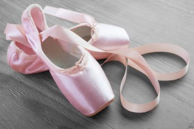 23290032 - new pink ballet point shoes on vintage wooden