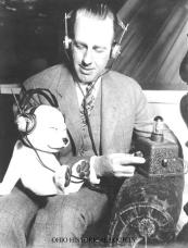 Powel Crosley Jr. from Cincinnati_ Ohio pictured with the wireless_ crystal radio set that he perfected and manufactured_ 1938. The stuffed toy dog on his lap was a company mascot known as the _Crosley Pup_.