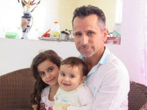 Christian Iraqi refugee father and daughters