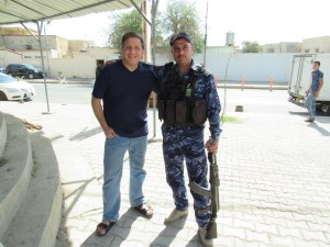 Scott with Iraqi police officer