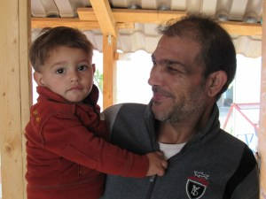 Syrian refugees, father and son, at Sunni camp in Akkar, Lebanon