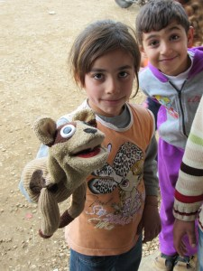 Syrian girl with Rocko, Sunni refugee camp, Akkar