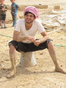 Bedouin refugee taking a break from making bricks