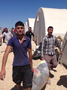 Yazidi men distributing clothing at Shariya Refugee Camp, Duhok