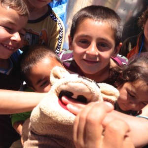 Yazidi kids hanging out with Rocko