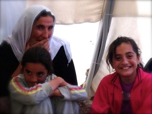 Enjoying tea and fellowship in a Yazidi family tent at Shariya refugee camp, Duhok, Iraq