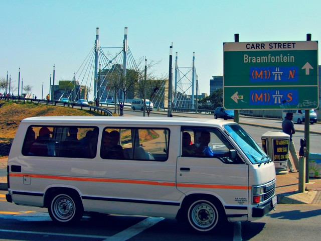 Taxi in front of Nelson Mandela Bridge