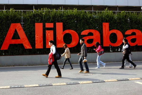 epa04130376 People walk in the headquarters campus of Alibaba Group, mother company of Chinese e-commerce giants Taobao and Tmall, in Hangzhou, Zhejiang province, China, 17 March 2014. Alibaba has announced its plan of initial public offering (IPO) in New York, USA that could value the firm at around 140 billion US dollar.  EPA/CRAB HU CHINA OUT