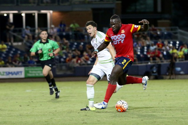 Arizona United's Uchenna Uzo, right, holds off a Seattle Sounders 2 player for the ball during a July 16 match at Peoria Sports Complex in Peoria. Photo credit: ArizonaUnited.com