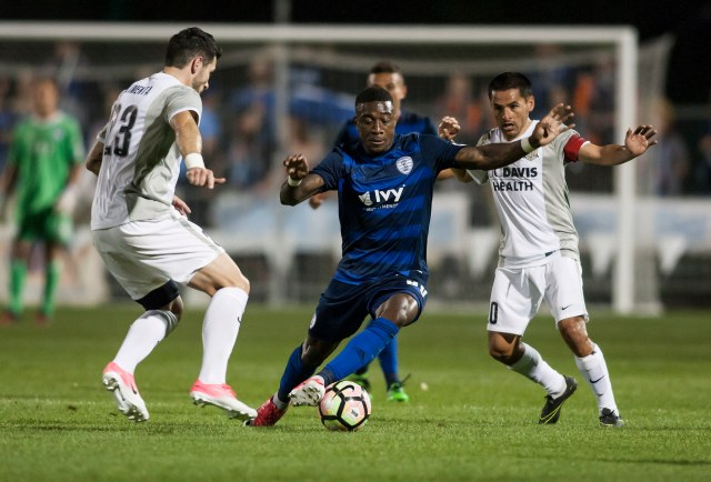 Swope Park Rangers forward Kharlton Belmar, center, dribbles by Sacramento Republic defenders Apr. 15 at Children's Mercy Victory Field in Kansas City, Mo. Photo by Nick Smith/Swope Park Rangers
