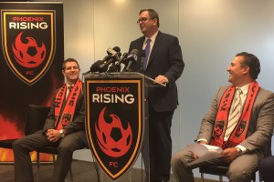 MLS Deputy Commissioner Mark Abbott (c) speaks to media following an official visit to Phoenix Rising FC