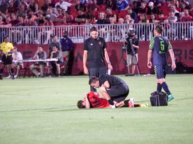 Alessandro Riggi is being attended to by the Phoenix Rising FC trainer against Oklahoma City FC May 13, 2017 at Phoenix Rising Soccer Complex in Scottsdale, Ariz. Photo by Aaron Blau/Firebird Rising