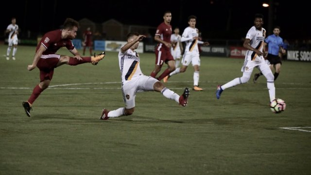 Phoenix Rising FC's Alessandro Riggi, bottom left, strikes the ball and scores in the first half against LA Galaxy II Saturday, Aug. 5, 2017 at the StubHub Center Track and Field Stadium in Carson, Calif. Photo by Michael Rincon/Phoenix Rising FC