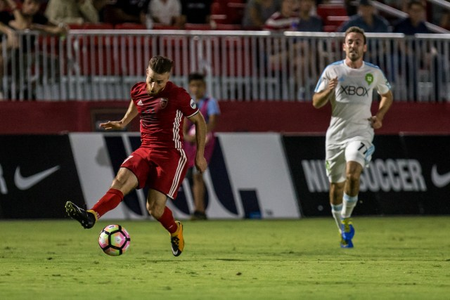 Phoenix Rising FC's Alessandro Riggi, left, dribbles past Seattle Sounders FC 2's Francisco Narbon during a game Sept. 2, 2017 at the Phoenix Rising Soccer Complex in Scottsdale, Ariz. Photo by Michael Rincon/Phoenix Rising FC