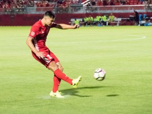 Phoenix Rising FC defender Kody Wakasa sends a ball into the final third against Oklahoma City on May 13, 2017 (Aaron Blau)