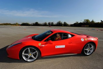 First Rides host Jason Grunsell drivinging a Ferrari 458 at the Ferrari test track of Fiorano in Italy 2013.