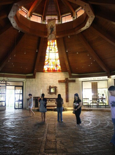 Devotees meditate as they walk through the labyrinth floor of the chapel.