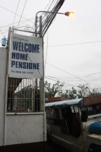 Welcome Home Pensione signage.