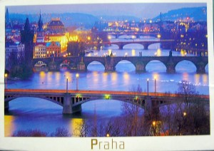 The river, the bridges, the lights aglow give a surreal feel to Prague.