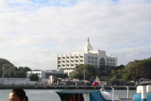 The city hall across the river.