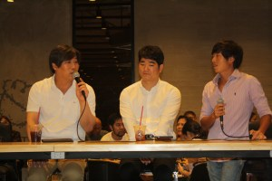 Tom N Toms CEO Kim Do Kyun (left) answers questions from the media.