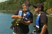 Ang shows Pete how catch and release fishing really works.