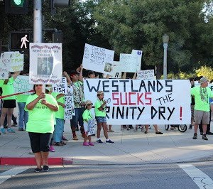 Photo of Hoopa Valley Tribe Members protesting Westlands Water District's salmon-kiling policies in Fresno in August 2013. Photo by Dan Bacher