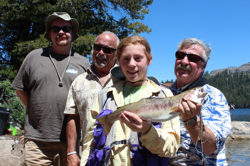 rteen-year-old Cecily Greenberg won the biggest fish award by catching a 20 inch rainbow weighing 2 pounds on PowerBait during the Lake Alpine Kid's Fishing Day on July 15. Behind her from left to right: Donald Connor, Bruno Huff and Stephan Krayk, all members of the Alpine County Fish and Game Commission.