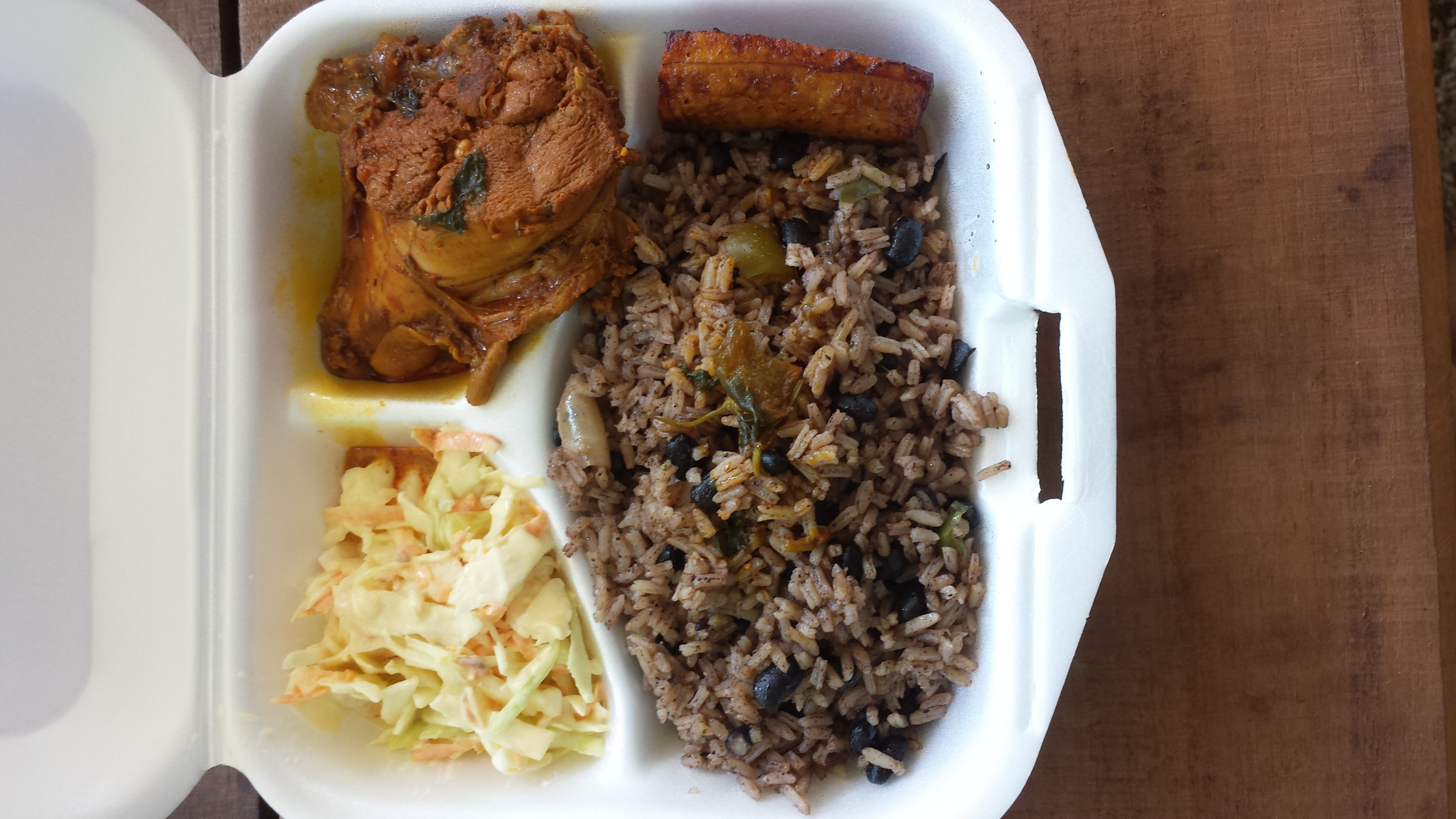 Jerk chicken with coleslaw and red beans & rice