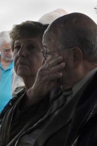 Paul Martin, oldest brother of Airman 3rd Class Howard Martin, wipes a tear from his eye during his brother's funeral July 12, 2014 in Elwood, Indiana. Howard Martin died November 22, 1952 during a C-124 crash in Alaska. His remains were not recovered or identified until earlier in 2014 and were returned home July 10, 2014. (U.S. Air Force photo/Senior Airman Sarah Hall-Kirchner)